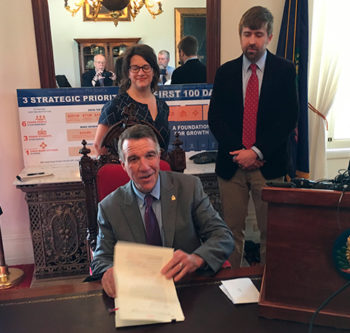Gov. Phil Scott signs Vermont's new shield law for journalists and their sources. Behind Scott, freelance journalists Hilary Niles and Dave Gram flank Paul Heintz of Seven Days of Burlington, Vt., a member of the Vermont Press Association board. They were part of a coalition of journalists that supported a call by the press association for a shield law.