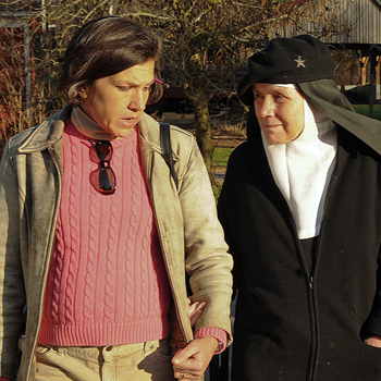Tracey O'Shaughnessy walks with the Rev. Mother Dolores Hart while interviewing her for a story exploring Mother Dolores' leaving a career as a Hollywood actress to become a nun. Jim Shannon photo, courtesy of Republican-American of Waterbury, Conn.