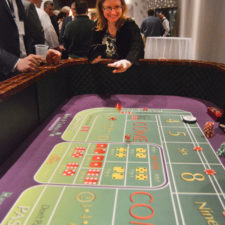 Kristen Braley, Stowe Reporter, tries craps table.