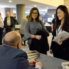 Jason Rezaian, keynote speaker, chats with Emerson journalism students Caroline Broderick and Frances Hui after autographing Frances' book.   Boston Renaissance Waterfront Hotel.