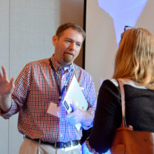 Tim Schmitt talks with one of the participants in his workshop
