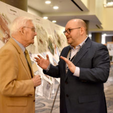 Keynote speaker Jason Rezaian of the Washington Post talks with Phillip Cabot Camp of the Vermont Standard at the New England Newspaper and Press Association's annual meeting, 2019.