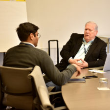 Bob Holt, talks with Utsav Gupta of Olin College in Needham during a one on one session at the New England Newspaper Convention, 2019.